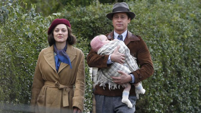Mandatory Credit: Photo by Beretta/Sims/REX/Shutterstock (5622106dm) Marion Cotillard and Brad Pitt with a baby 'Five Seconds of Silence' on set filming, London, Britain - 31 Mar 2016