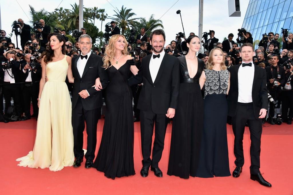 "CANNES, FRANCE - MAY 12: (L-R) Lawyer Amal Clooney, actors George Clooney, Julia Roberts, Dominic West, Caitriona Balfe, producer Jodie Foster and actor Jack O'Connell attend the ""Money Monster"" premiere during the 69th annual Cannes Film Festival at the Palais des Festivals on May 12, 2016 in Cannes, France. (Photo by Pascal Le Segretain/Getty Images)"